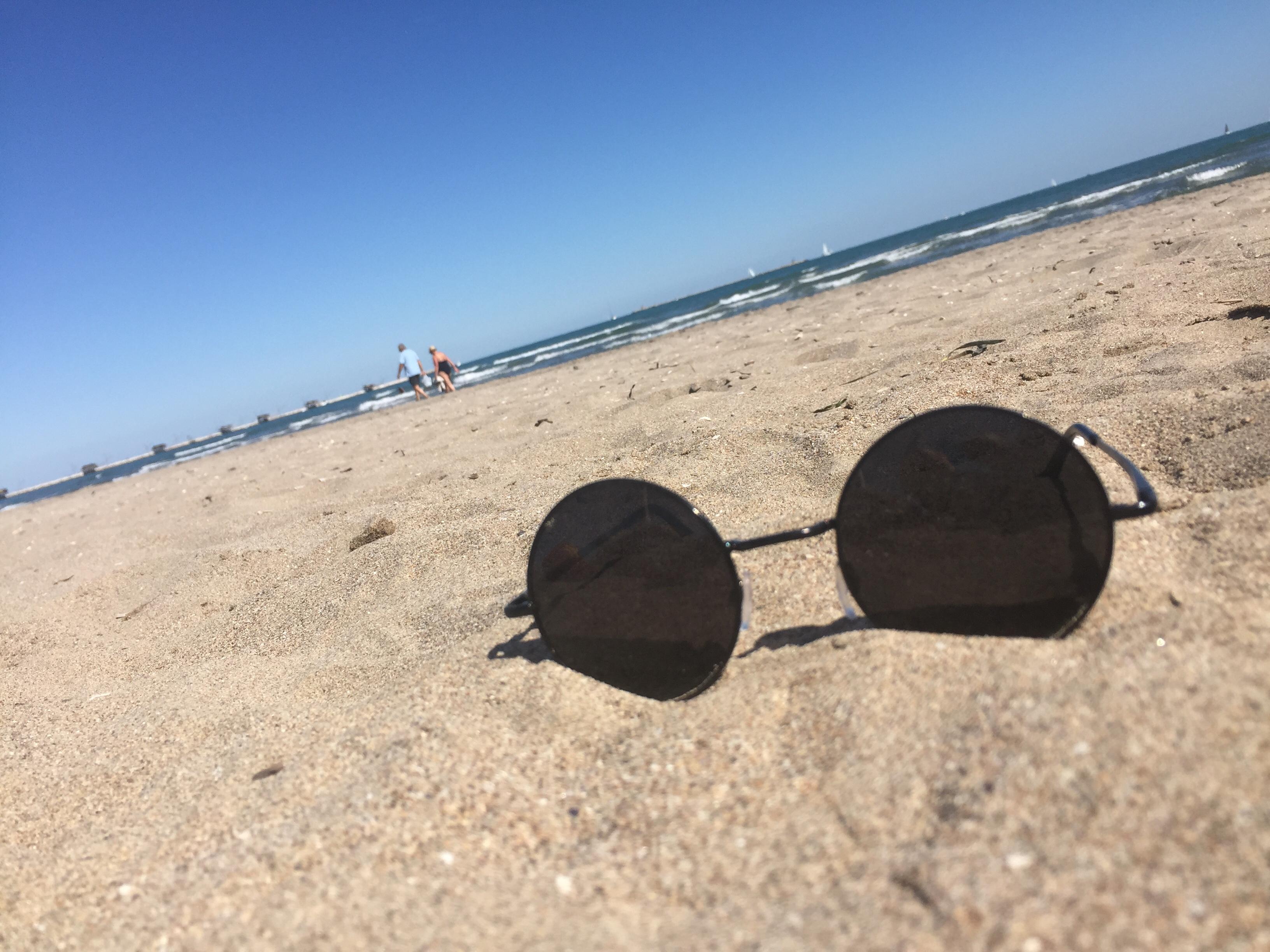 solbriller dekket av reiseofrsikring